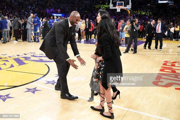Kobe Bryant runs after his family at halftime after both his and Los Angeles Lakers jerseys are retired at Staples Center on December 18 2017 in Los...