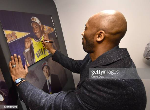 Kobe Bryant signs autographs launches Granity Studios' debut book The Wizenard Series Training Camp to young athletes at the flagship NBA Store on...