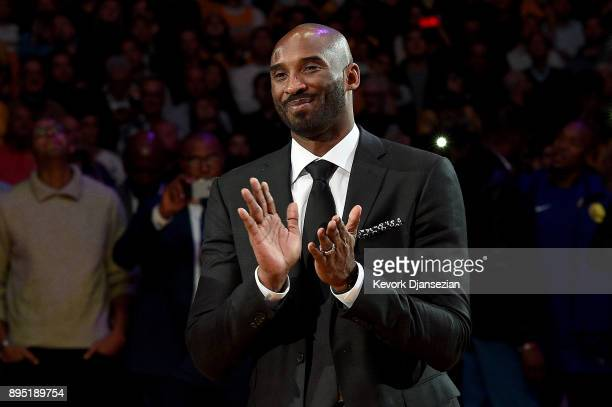 Kobe Bryant smiles at halftime as both his and Los Angeles Lakers jerseys are retired at Staples Center on December 18 2017 in Los Angeles California...