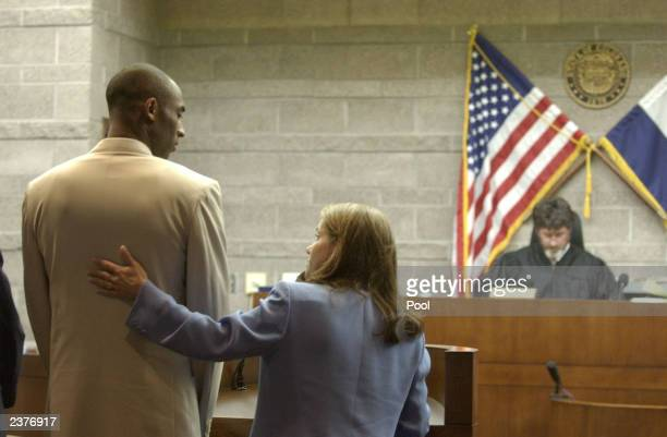 Kobe Bryant the Los Angeles Lakers basketball player looks at his lawyer Pamela Mackey during an an advisement hearing in the courtroom of Judge Fred...