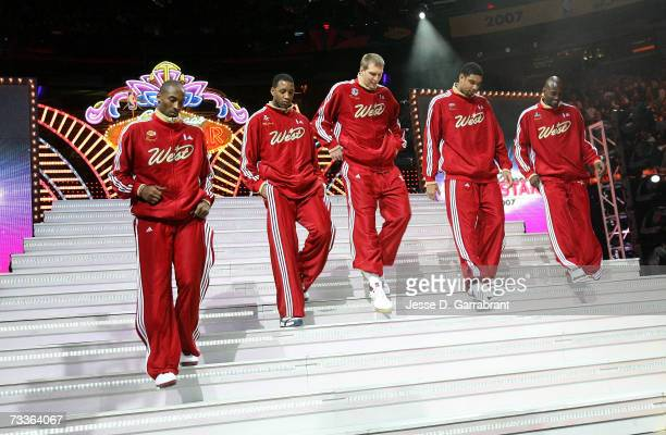 Kobe Bryant, Tracy McGrady, Dirk Nowitzki, Tim Duncan and Kevin Garnett of the Western Conference take the court during player introductions during...