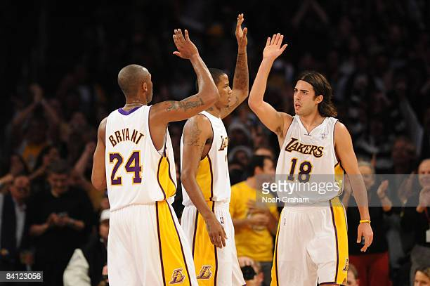 Kobe Bryant Trevor Ariza and Sasha Vujacic of the Los Angeles Lakers slap hands during their game against the Boston Celtics at Staples Center on...