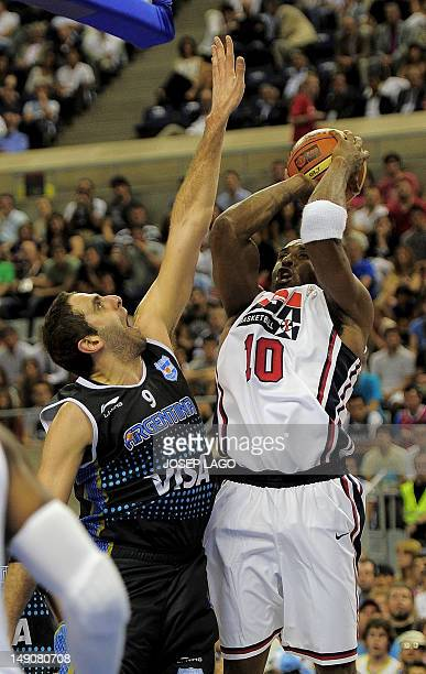 US Kobe Bryant vies with Argentinian Juan PGutierrez during their Olympic warm up game against Argentina at the Palau Sanrt Jordi Arena in Barcelona...