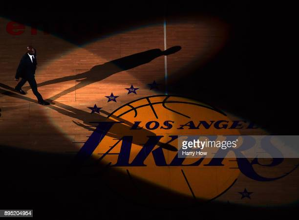 Kobe Bryant walk out to center court during his jersey retirement ceremony at halftime of a basketball game between the Los Angeles Lakers and the...