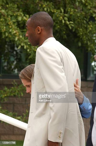 Kobe Bryant walks into the Eagle County Court with his attorney Pamela Mackey Bryant is charged with felony sexual assault against a 19 year old...