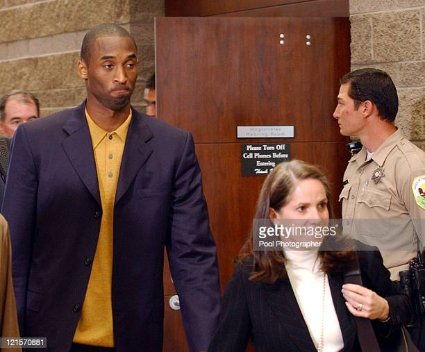 Kobe Bryant walks the hallway outside of the Eagle County courtroom with his attorney Pamela Mackey right as they decided to go ahead with the...