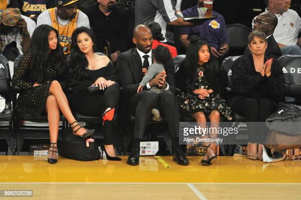Kobe Bryant, wife Vanessa Bryant and daughters Gianna Maria Onore Bryant, Natalia Diamante Bryant and Bianka Bella Bryant attend a basketball game...