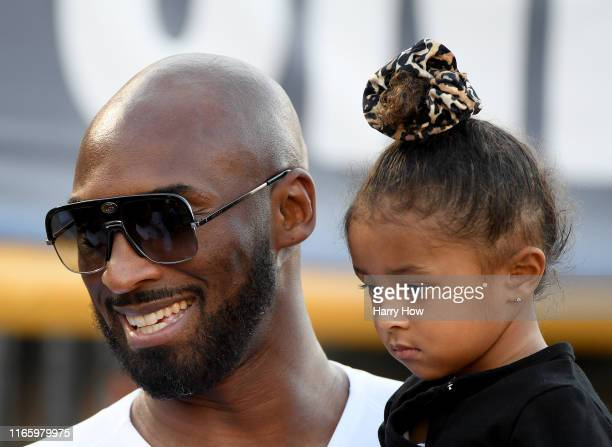 Kobe Bryant with daughter Biaka Bryant before the game between the United States and the Republic of Ireland during the USWNT Victory Tour at Rose...