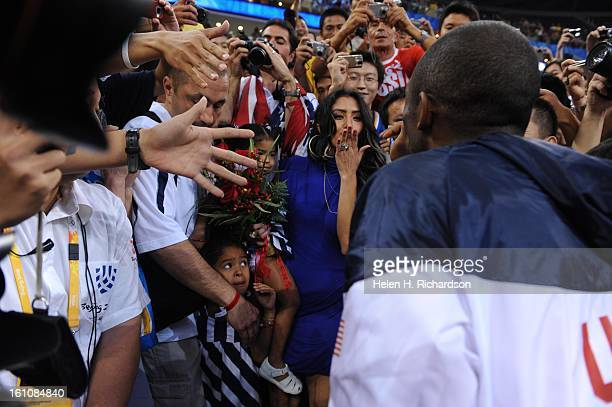Kobe Bryant's wife Vanessa blows the NBA star a kiss after their win over Spain in the gold medal round Along with her are their two young children...