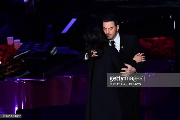 Kobe Bryant's wife Vanessa Bryant hugs US television host Jimmy Kimmel as she arrives to speak during the Celebration of Life for Kobe and Gianna...