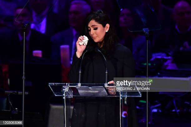 TOPSHOT Kobe Bryant's wife Vanessa Bryant wipes away tears as she speaks during the Celebration of Life for Kobe and Gianna Bryant service at Staples...