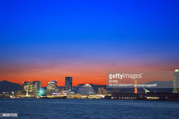 Kobe harbour and city skyline in the evening,  Kobe,  Hyogo Prefecture,  Japan