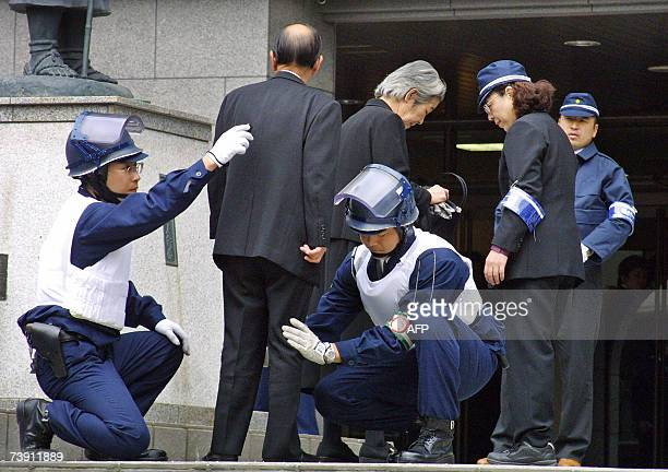 This 20 April 2002 picture shows members of Japan's largest organised crime syndicate the Yamaguchigumi gathering at a funeral of their boss in Kobe...