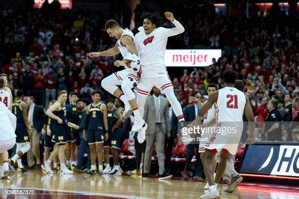 Kobe King and Tai Strickland of the Wisconsin Badgers celebrate after beating the Michigan Wolverines 64-54 at the Kohl Center on January 19, 2019 in...