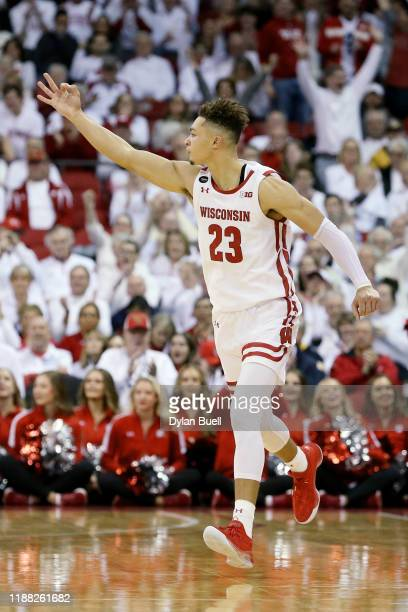 Kobe King of the Wisconsin Badgers reacts in the second half against the Marquette Golden Eagles at the Kohl Center on November 17, 2019 in Madison,...