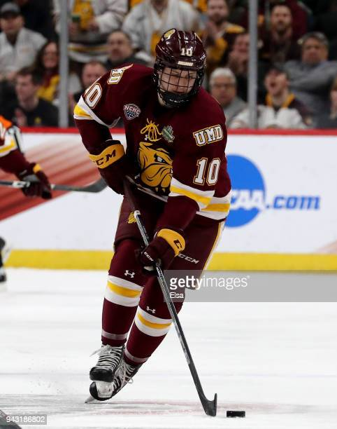 Kobe Roth of the MinnesotaDuluth Bulldogs skates with the puck in the first period against the Notre Dame Fighting Irish during the championship game...