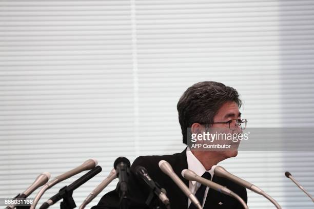 Kobe Steel Executive Vice President Naoto Umehara listens to a question during a press conference in Tokyo on October 30 2017 Kobe Steel reeling from...