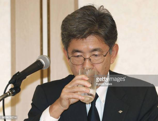 Kobe Steel Ltd Executive Vice President Naoto Umehara drinks water during a press conference in Tokyo on Oct 20 2017 The thirdlargest Japanese...