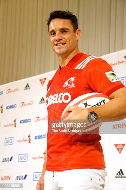 Kobelco Steelers new player Dan Carter and team manager Masayuki Fukumoto pose for photographs during a press conference on July 16 2018 in Kobe...