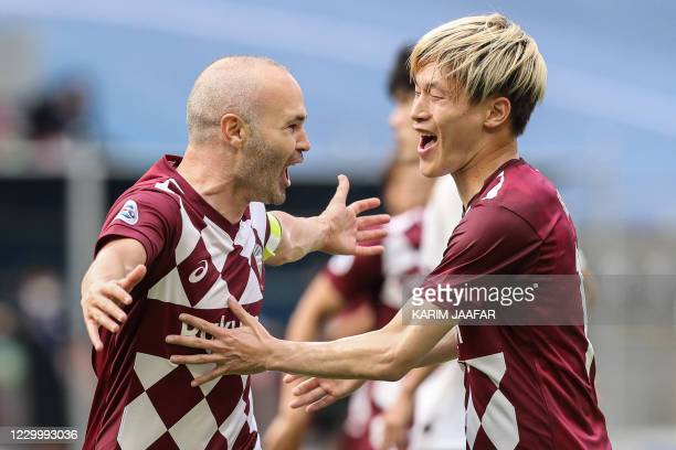 Kobe's midfielder Andres Iniesta celebrates his goal with teammates during the AFC Champions League round of 16 football match between Japan's Vissel...