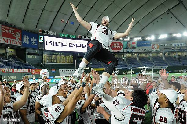 Kobey Cameron of the Frontiers celebrates with meate mates after winning the Rice Bowl match between Fujitsu Frontiers and Kwansei Gakuin University...