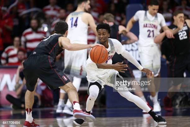 Kobi Simmons of the Arizona Wildcats defends Christian Sanders of the Stanford Cardinal during the second half of the college basketball game at...