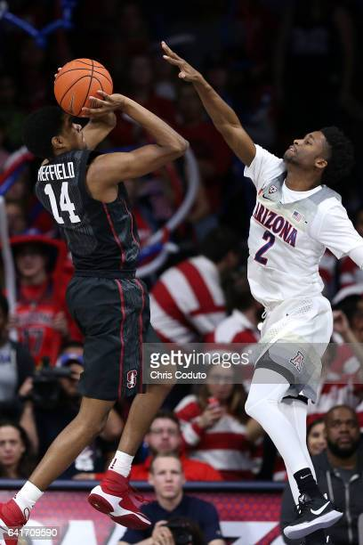 Kobi Simmons of the Arizona Wildcats defends Marcus Sheffield of the Stanford Cardinal during the second half of the college basketball game at...