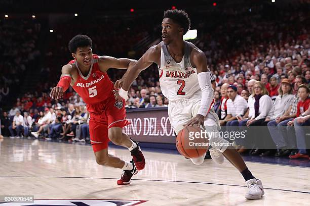 Kobi Simmons of the Arizona Wildcats drives the ball past Jalen Harris of the New Mexico Lobos during the first half of the college basketball game...