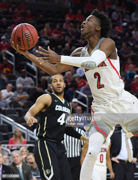 Kobi Simmons of the Arizona Wildcats drives to the basket in front of Josh Fortune of the Colorado Buffaloes during a quarterfinal game of the Pac-12...