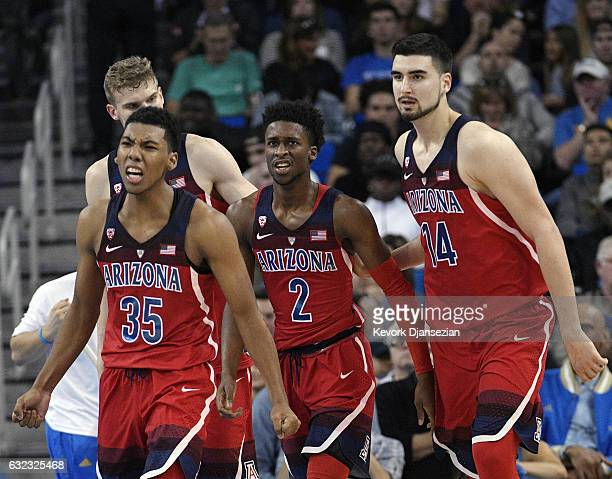 Kobi Simmons of the Arizona Wildcats is congratulated by his teammates Dusan Ristic and Allonzo Trier after he scored a basket against UCLA during...