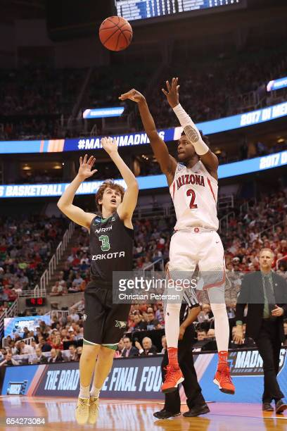 Kobi Simmons of the Arizona Wildcats is defended by Billy Brown of the North Dakota Fighting Sioux during the first round of the 2017 NCAA Men's...