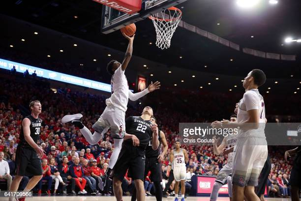 Kobi Simmons of the Arizona Wildcats shoots over Reid Travis of the Stanford Cardinal during the second half of the college basketball game at McKale...