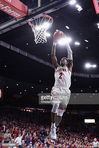 Kobi Simmons of the Arizona Wildcats slam dunks the ball against the Sacred Heart Pioneers during the first half of the college basketball game at...