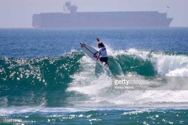 Kobie Enright of Australia surfs in Heat 1 of the Round of 64 at the US Open of Surfing Huntington Beach presented by Shiseido on September 21, 2021...