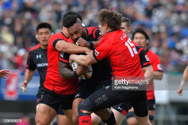 Kobus van Dyk of Canon Eagles is tackled during the Rugby Top League match between Canon Eagles and Honda Heat at the Kumagaya Rugby Stadium on...