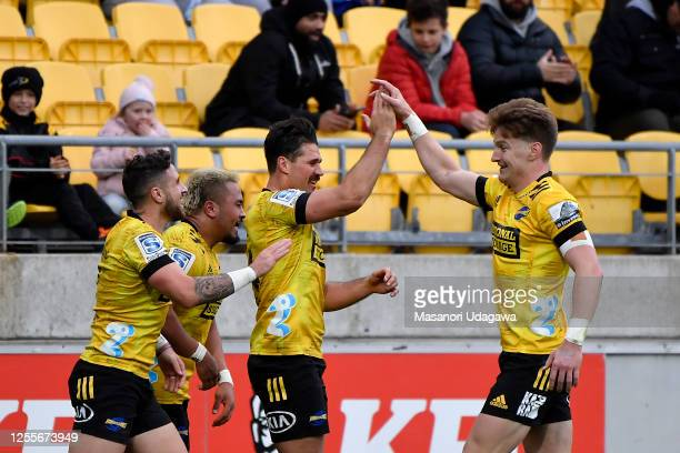 Kobus Van Wyk of the Hurricanes celebrates with team mates after scoring a try during the round 5 Super Rugby Aotearoa match between the Hurricanes...