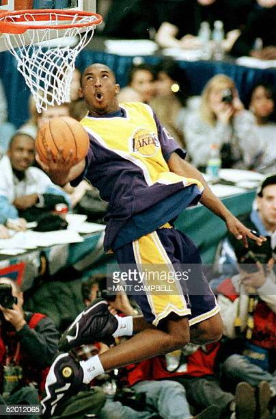 Koby Bryant of the Los Angeles Lakers eyes the baskets during the NBA Slam Dunk contest 08 February at Gund Arena in Cleveland Ohio Bryant is the...