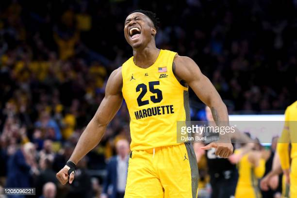 Koby McEwen of the Marquette Golden Eagles celebrates in the second half against the Butler Bulldogs at the Fiserv Forum on February 09, 2020 in...