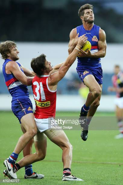 Koby Stevens of the Bulldogs marks the ball against Tom Simpkin of the Saints during the round two AFL NAB Challenge Cup match between the Western...