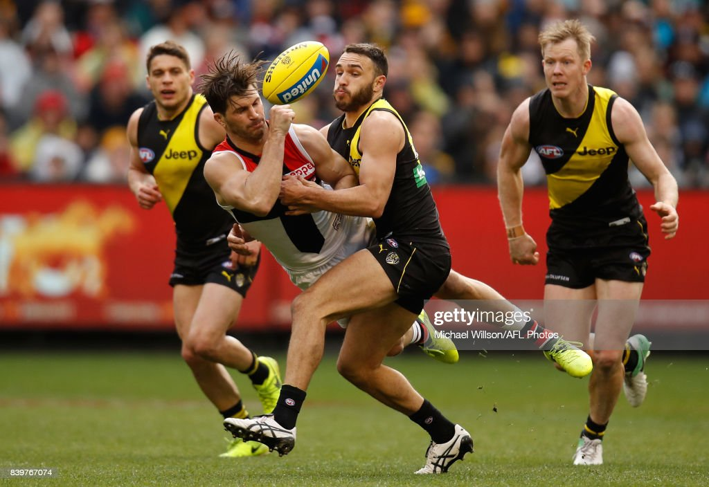 Koby Stevens of the Saints is tackled by Shane Edwards of the Tigers during the 2017 AFL round 23 match between the Richmond Tigers and the St Kilda Saints at the Melbourne Cricket Ground on August 27, 2017 in Melbourne, Australia.