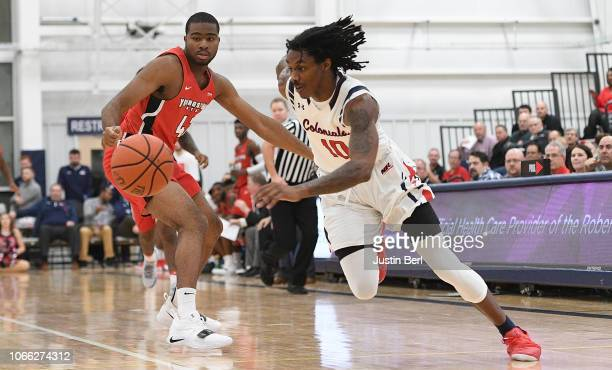 Koby Thomas of the Robert Morris Colonials dribbles past Alex Holcombe of the Youngstown State Penguins during the second half in the game at the...