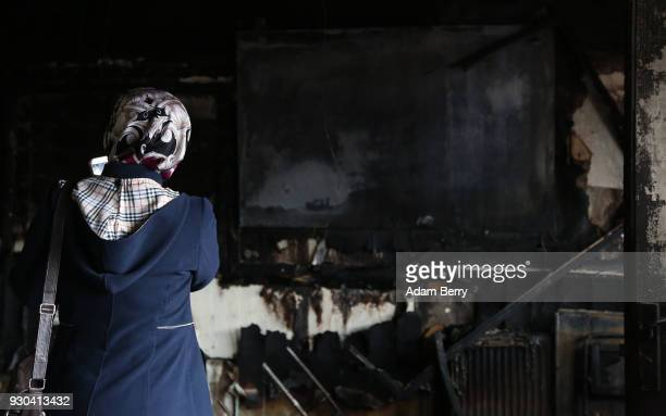 Koca Sinan Camii mosque congregation member looks at damage the day after a fire in the building the previous night on March 11 2018 in Berlin...