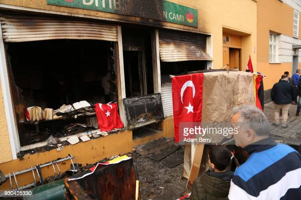 Koca Sinan Camii mosque congregation members look at damage the day after a fire there the previous night on March 11 2018 in Berlin Germany...