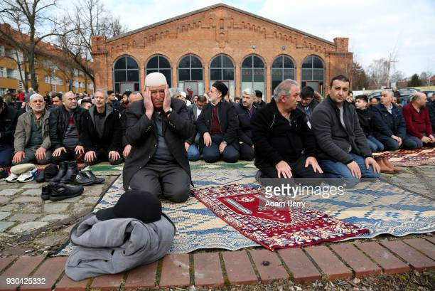 Koca Sinan Camii mosque congregation members pray outside having nowhere to do so inside their mosque the day after a fire there the previous night...