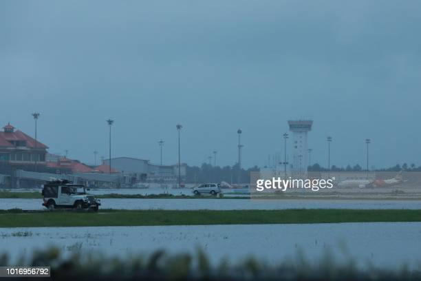 Kochi's International airport apron is seen flooded following monsoon rains in the Indian state of Kerala on August 15 2018 Indian authorities on...