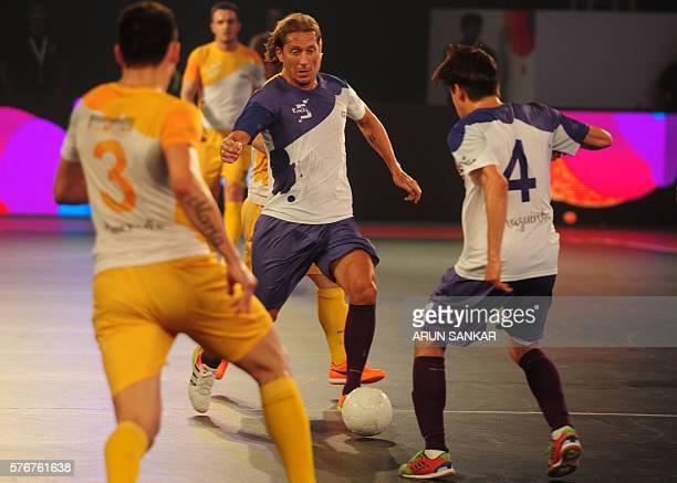 Kochi's Miguel Salgado plays against Chennai 5's during their Premier Futsal Football League match in Chennai on July 17 2016 / AFP / ARUN SANKAR