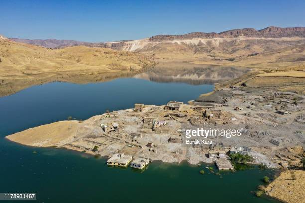 Koctepe village is seen deserted and invaded by filling water on the reservoir of Turkey's fourth biggest dam of Ilisu on October 02 2019 in Mardin...