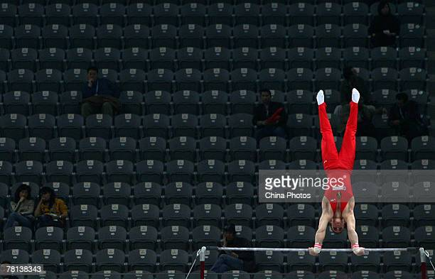 """Koczi Flavius of Roumania performs on the horizontal bar during the men's qualification competition of the """"Good Luck Beijing"""" Gymnastics..."""