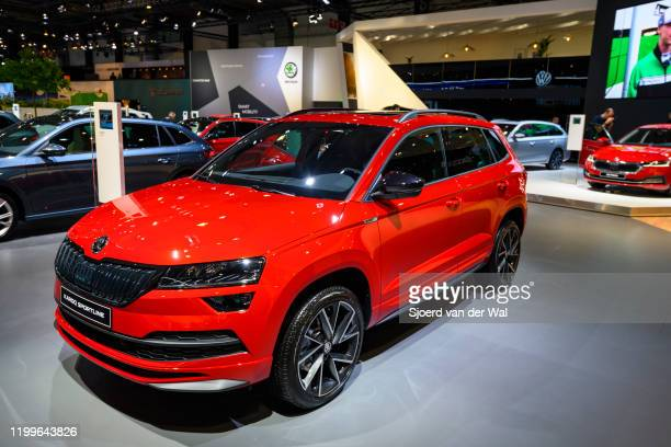 Škoda Karoq Sportline compact crossover SUV display at Brussels Expo on January 9, 2020 in Brussels, Belgium. The koda Karoq is available with two...