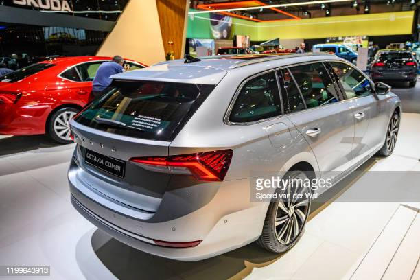 Škoda Octavia Combi station wagon with the Skoda Octavia sedan in the background on the Skoda motor show stand on display at Brussels Expo on January...